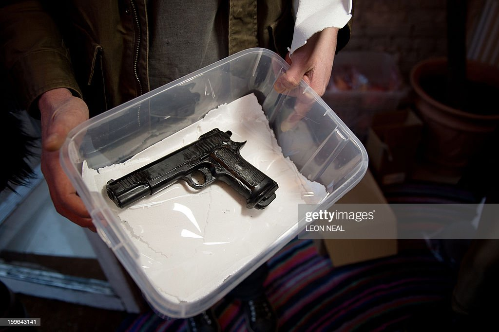 An entirely edible replica pistol made of chocolate is displayed at a film set pop-up experience in east London on January 17, 2013. The event was held to promote the release of a new horror film 'The Helpers'. AFP PHOTO / LEON NEAL