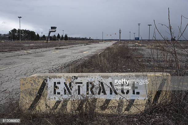 An 'Entrance' sign sits at the former site of the General Motors Co powertrain plant inside the Willow Run airport in Ypsilanti Michigan US on...