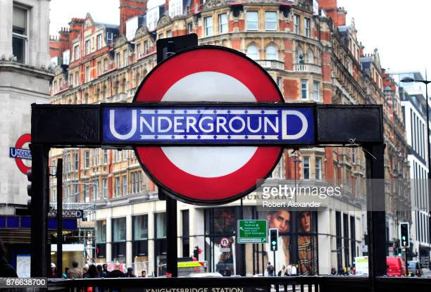 An entrance to the Knightsbridge underground or tube station in London England near the landmark Harrods department store