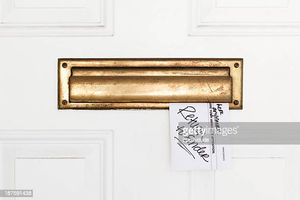 An envelope stuck in a mail slot with Return to Sender written on it