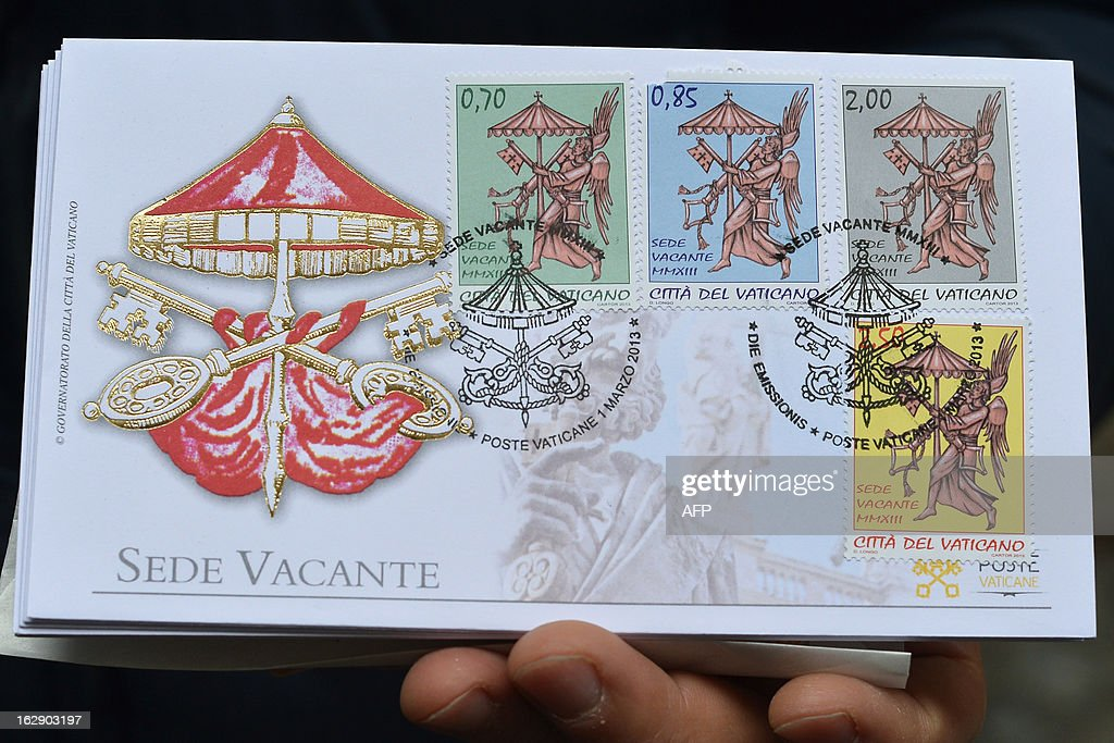 An enveloppe with the stamps for use during the 'Sede Vacante', or Vacant See, created by the historic resignation of pope Benedict XVI, is displayed on the day they were issued on March 1, 2013 at the Vatican. The unusual interregnum stamps, a series of four, include the Vacant See symbol -- a striped umbrella over crossed keys -- as well as the words Sede Vacante, Citta del Vaticano and MMXIII, the year in Roman numerals.