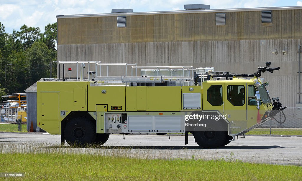 An E-ONE Inc. Airport Rescue Fire Fighter (ARFF) truck sits outside the E-ONE factory, on Tuesday, Aug. 20, 2013, in Ocala, Florida, U.S. The U.S. Census Bureau is scheduled to release durable goods figures on Aug. 26. Photographer: Mark Elias/Bloomberg via Getty Images