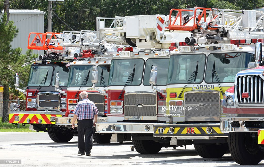 An E-ONE Inc. company lean leader inspects completed aerial fire trucks at the E-ONE factory, on Tuesday, Aug. 20, 2013, in Ocala, Florida, U.S. The U.S. Census Bureau is scheduled to release durable goods figures on Aug. 26. Photographer: Mark Elias/Bloomberg via Getty Images