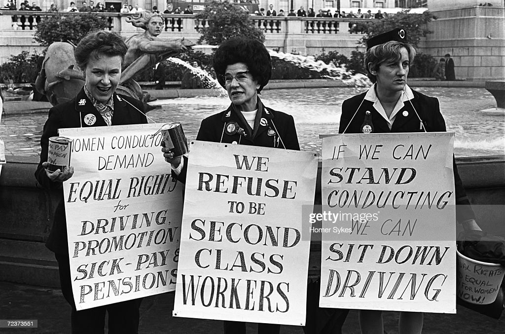 An Equal Pay for Equal Work demonstration in London's Trafalgar Square, 1968. Three female bus conductors with placards demand equal rights to their male colleagues.