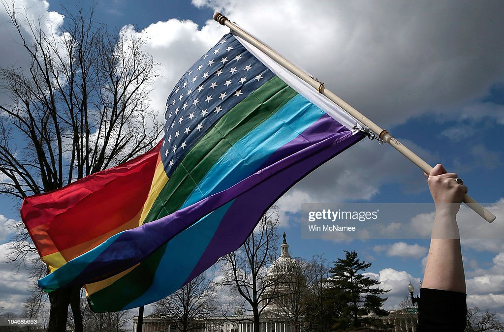 An equal rights supporter waves a flag during demonstration in front of the U.S. Supreme Court March 26, 2013 in Washington, DC. The Supreme Court is hearing arguments March 26, in California's proposition 8, the controversial ballot initiative that defines marriage only between a man and a woman.