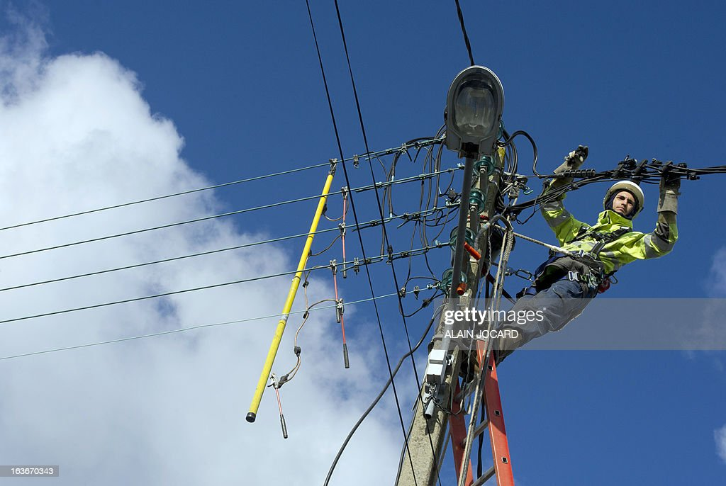 An ERDF (Electricity Network Distribution France) technician fixes a damaged power line after heavy snowfalls on March 14, 2013 in Gatteville-Le-Phare, , northern France. More than 68,000 homes were without electricity in France and hundreds of people were trapped in their cars after a winter storm hit with heavy snow, officials and weather services said on March 12. Twenty-six regions in northwest and northern France were put on orange alert because of heavy snowfalls, which Meteo France said were 'remarkable for the season because of the expected quantity and length of time'.