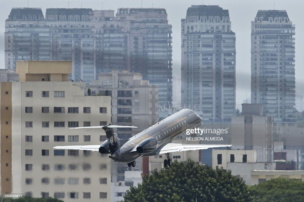An ERJ 145 Embraer aircraft of the Brazilian federal police takes off from Congonhas Airport in Sao Paulo destined to Brasilia with two of the...