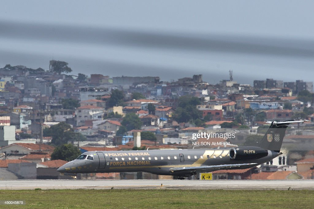An ERJ 145 Embraer aircraft of the Brazilian federal police waits for take-off from Congonhas Airport in Sao Paulo, destined to Brasilia, with two of the accused in the Mensalao scandal - Jose Dirceu, former Chief of Staff of President Luiz Inacio Lula da Silva, and Jose Genoino, former president of the Workers Party (PT) on November 16, 2013. Several figures who recently wielded considerable political influence, including Genoino and Lula's former chief of staff Jose Dirceu, face detention under a semi-open regime. AFP PHOTO / NELSON ALMEIDA