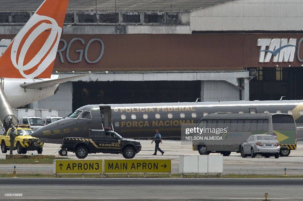An ERJ 145 Embraer aircraft of the Brazilian federal police waits for take-off from Congonhas Airport in Sao Paulo, destined to Brasilia, with two of the accused in the Mensalao scandal - Jose Dirceu, former Chief of Staff of President Luiz Inacio Lula da Silva, and Jose Genoino, former president of the Workers Party (PT) on November 16, 2013. Several figures who recently wielded considerable political influence, including Genoino and Lula's former chief of staff Jose Dirceu, face detention under a semi-open regime.