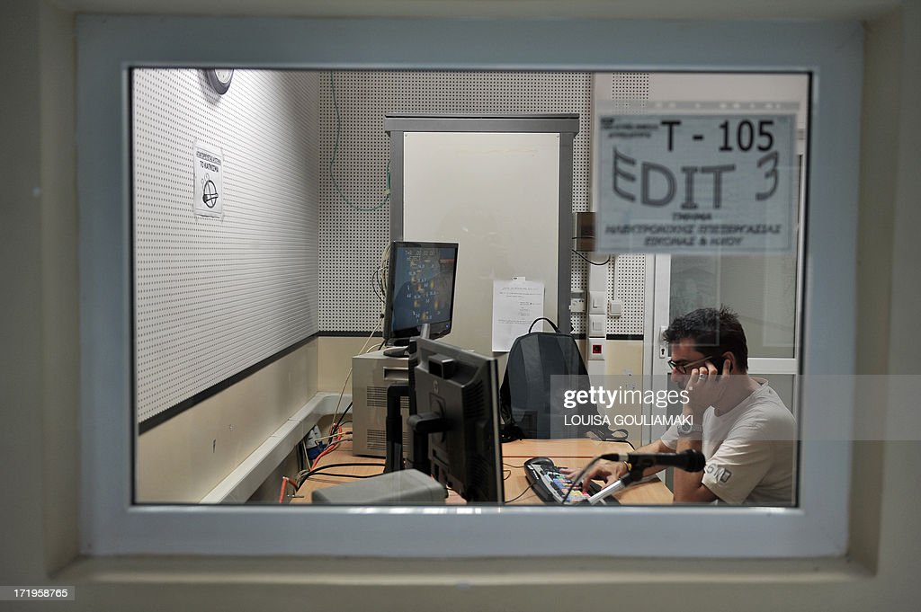 HADOULIS - An ERT employee prepares the weather report in an editing room of broadcaster's headquarters in Athens on June 28, 2013. Inside Greece's public broadcaster ERT, employees face an uncertain future after the government pulled the plug on the historic company this month to meet pressing cost-cutting requirements by the country's EU-IMF creditors. Some 2,700 staff became redundant almost overnight, and many will not return when a slimmed-down version of the broadcaster eventually returns to the airwaves as the government promises. But even though in limbo, ERT's employees are revelling in newfound independence from state control for the first time in their careers at the company.They are putting the experience to good use, running ERT themselves for the past three weeks in a self-management operation whose sort is unprecedented in Greece.