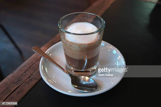 An espresso macchiato sits freshly served at a cafe on October 2 2016 in Berlin Germany Coffee culture is thriving in Berlin