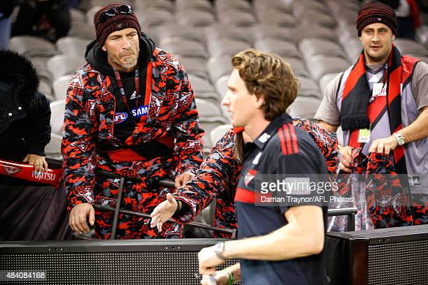 An Essendon supporter gives words of encouragement to coach James Hird after the round 20 AFL match between the Essendon Bombers and the Adelaide...