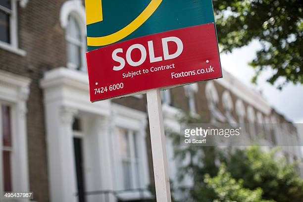 An estate agent sold sign is displayed outside a property on June 3 2014 in London England Figures from the Nationwide the UK's largest building...