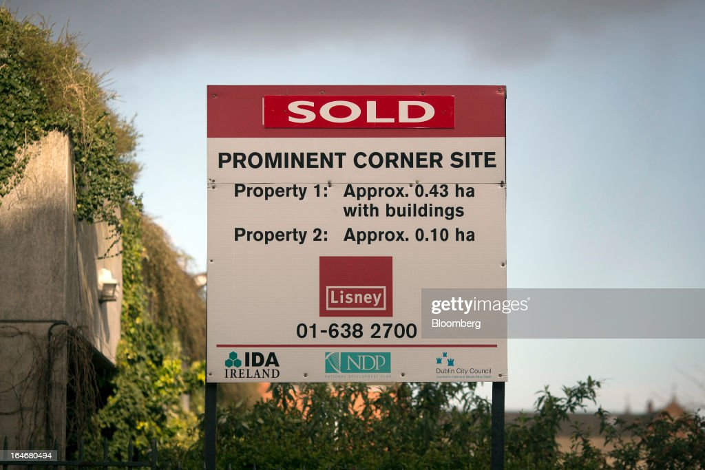 An estate agent's board shows 'Sold' on a plot of land at Lower Gardiner Street in Dublin, Ireland, on Saturday, March 16, 2013. Ireland's renewed competiveness makes it a beacon for the U.S. companies such as EBay, Google Inc. and Facebook Inc., which have expanded their operations in the country over the past two years. Photographer: Simon Dawson/Bloomberg via Getty Images