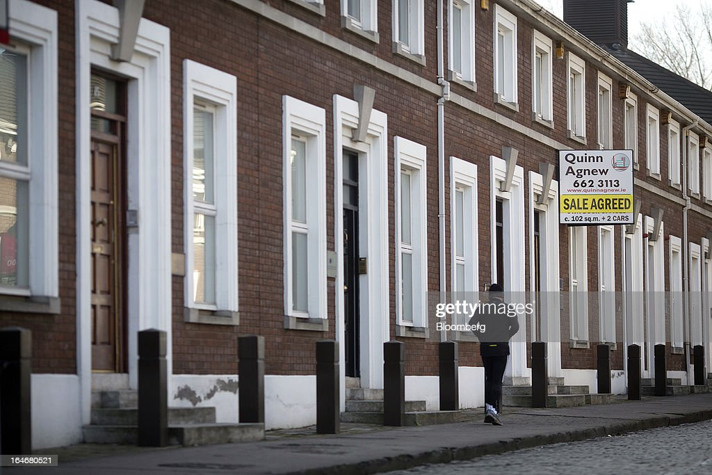 An estate agents sign reads 'Sale Agreed' outside residential properties near to Grand Canal Dock in Dublin, Ireland, on Saturday, March 16, 2013. Ireland's renewed competiveness makes it a beacon for the U.S. companies such as EBay, Google Inc. and Facebook Inc., which have expanded their operations in the country over the past two years. Photographer: Simon Dawson/Bloomberg via Getty Images