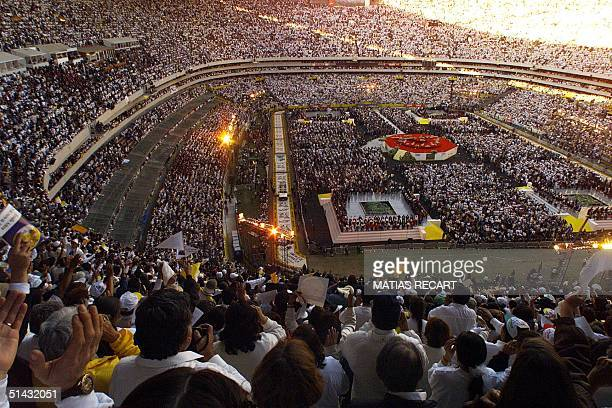 An estimated 120000 rise to their feet as Pope John Paul II enters the Azteca stadium in the popemobile 25 January for a massive rally described as...