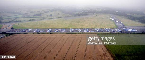 An estimated 1300 Subaru car owners spell out Colin McRae's name at the Prodrive test track in Banbury Oxfordshire to pay tribute to the late...
