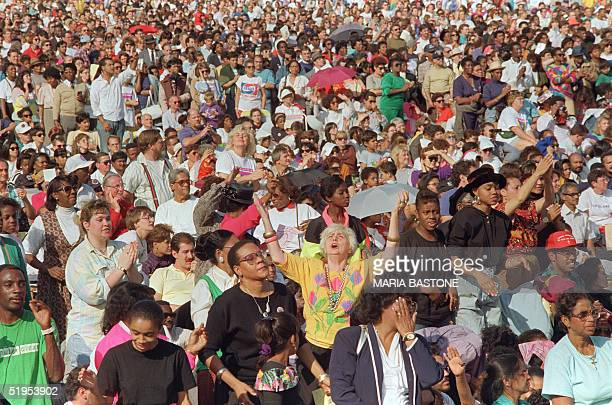 An estimated crowd of 200000 faithful gathered in Central Park listen 22 September 1991 to the sermon of Billy Graham the American evangelist Graham...