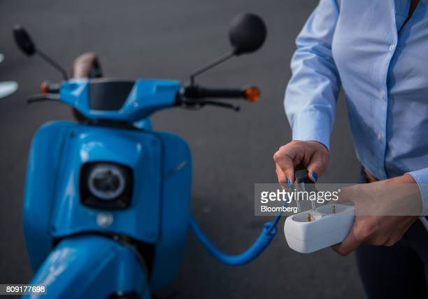 An eSwallow electric motor scooter manufactured by Horex GmbH with electric drive systems developed by Robert Bosch GmbH is connected to an...