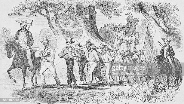An etching depicting a group of slaves being marched while they are bound together with chains they are being led by white men on horses who carry...
