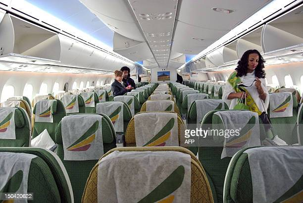 An Ethiopian Airlines stewardess inspects the aisles of a Boeing 787 Dreamliner on arrival in Addis Ababa on August 17 2012 Ethiopian Airlines...