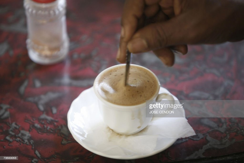 An Ethiopian man stirs coffee inside a fake Starbucks coffee shop 12 March 2007 in the northern Ethiopian city of Mekele AFP PHOTO/JOSE CENDON