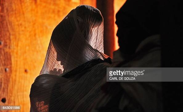 An Ethiopian Orthodox Christian female pilgrim is pictured at a mass before the annual festival of Timkat in Lalibela Ethiopia which celebrates the...