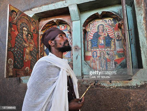 An Ethiopian Orthodox Christian monk looks up while holding a cross at Ure Kidane Mihret monastery at Lake Tana in Bahar Dar Ethiopia on January 17...