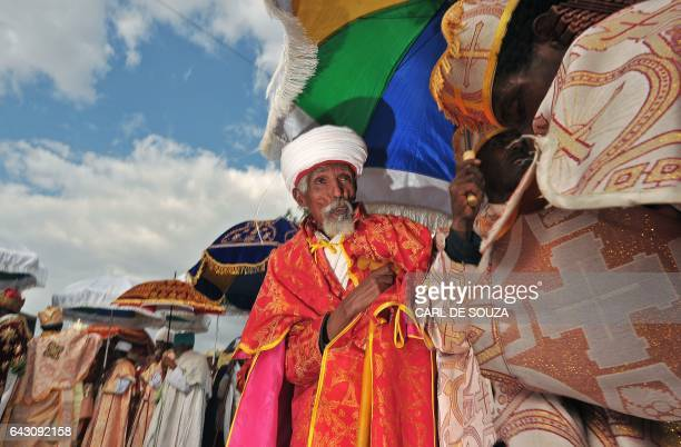 An Ethiopian Orthodox Priest is pictured during the annual festival of Timkat in Lalibela Ethiopia which celebrates the Baptism of Jesus in the...