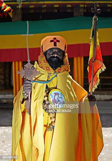 An Ethiopian orthodox priest poses for a photo during the Timkat festival in Gondar on January 18 2014 Timkat is the Ethiopian Orthodox Christian...
