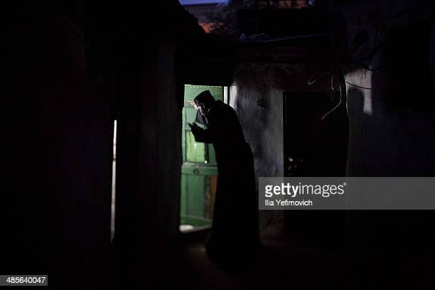 An Ethiopian Orthodox worshipper waits for the ceremony of the Holy Fire to begin at the Deir AlSultan the Ethiopian section of the Church of the...