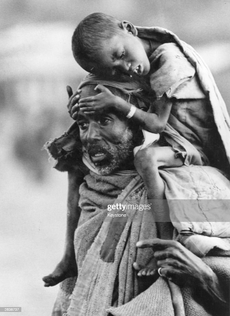 An Ethiopian refugee carrying a starving boy Years of drought civil war and a shortage of food water and fuel have resulted in the worst famine since...