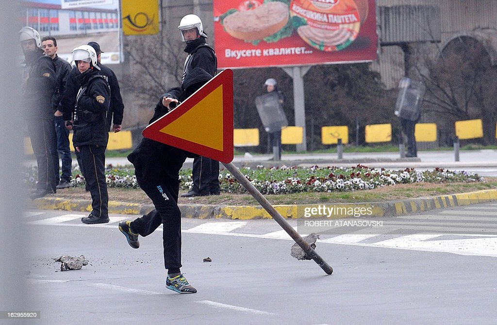 An Ethnic Albanian carry a road sign during clashes with Macedonian riot police in Skopje on March 2, 2013. A demonstration was organized by ethnic Albanians on March 2 in support of the new Defense Minister, former guerrilla commander Talat Xhaferi, following violent protests on March 1 when ethnic Macedonians protested against his appointment, according to local media.