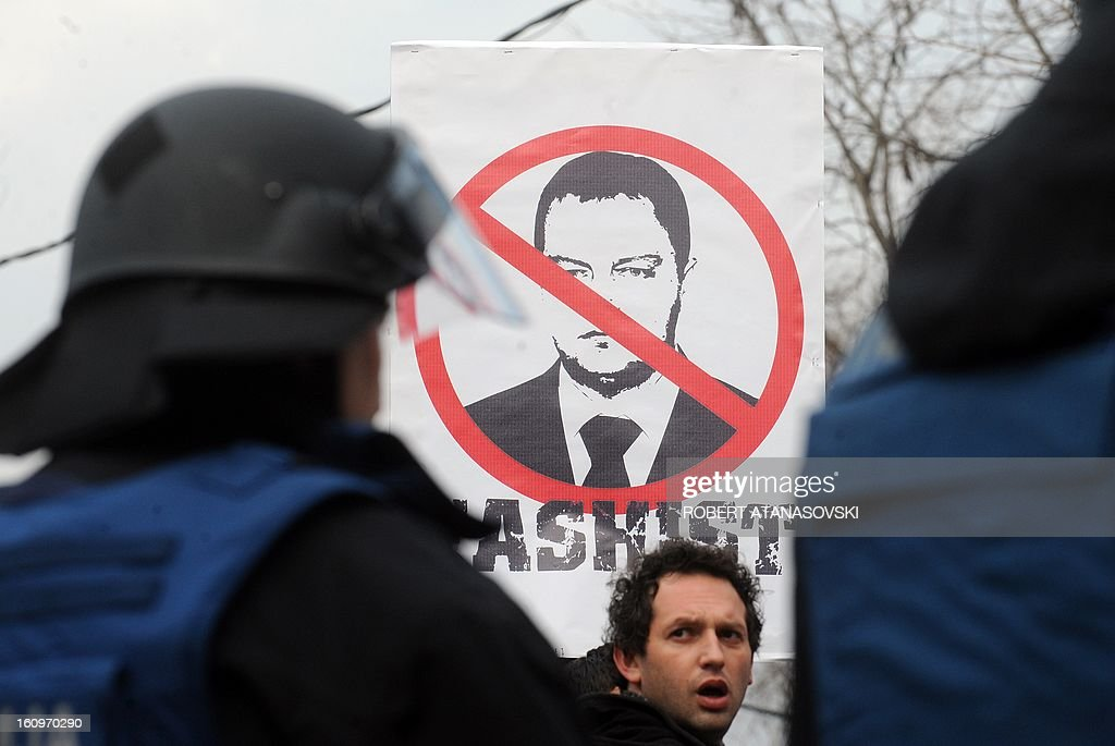"An ethnic Albanian holds a banner with a picture of Serbian Prime Minister Ivica Dacic with the word ""Facist"", during a protest rally near the Serbian embassy in Skopje on February 8, 2013. Former members of the Kosovo Liberation Army (KLA) protest against Serbia after a memorial to ethnic Albanian rebels in southern Serbia was forcibly removed. Serbian authorities had ordered the removal of a controversial monument honoring members of the so-called Liberation Army of Presevo, Medveda and Bujanovac (UCPMB), in Presevo, Serbia, on January 20."