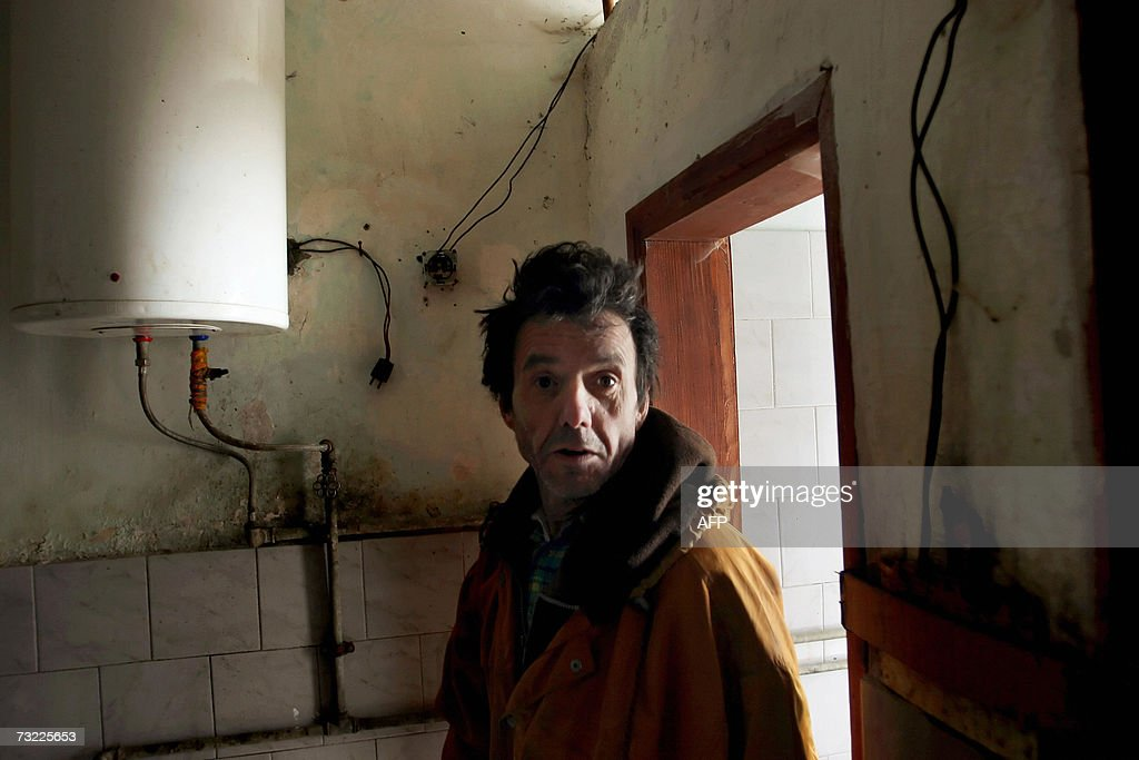 An Ethnic Albanian man is seen in a collective bathroom at a refugee house in Stari Trg, 06 February 2007. Some 100 Kosovo Albanian refugees living in unbearable conditions at the refugee house in Stari Trg. They are settled in a house that is the municipality?s property. All of them expect their conditions to improve once the status is settled. The Kosovo negotiating team here said, 05 February it would participate in UN-sponsored talks on the ethnic Albanian majority province's future status in Vienna later this month. Kosovo has been run by a UN mission since mid-1999, when a NATO bombing campaign drove out Serbian forces engaged in a brutal crackdown on ethnic Albanians.