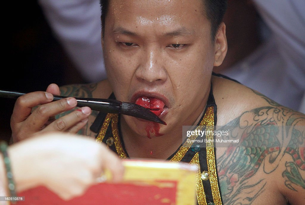 An ethnic Chinese Indonesian uses blood from a self inflicted wound on his tongue to write a spell on ritual papers during a Chap Goh Meh celebration on February 24, 2013 in Jakarta, Indonesia. Today locals are celebratinh the Chap Goh Meh, which is the 15th day of Chinese New Year and represents the end of the Chinese New Year celebrations. Traditionally,people visit temples and offer prayers in order to receive blessings and good fortune from the God of Prosperity.