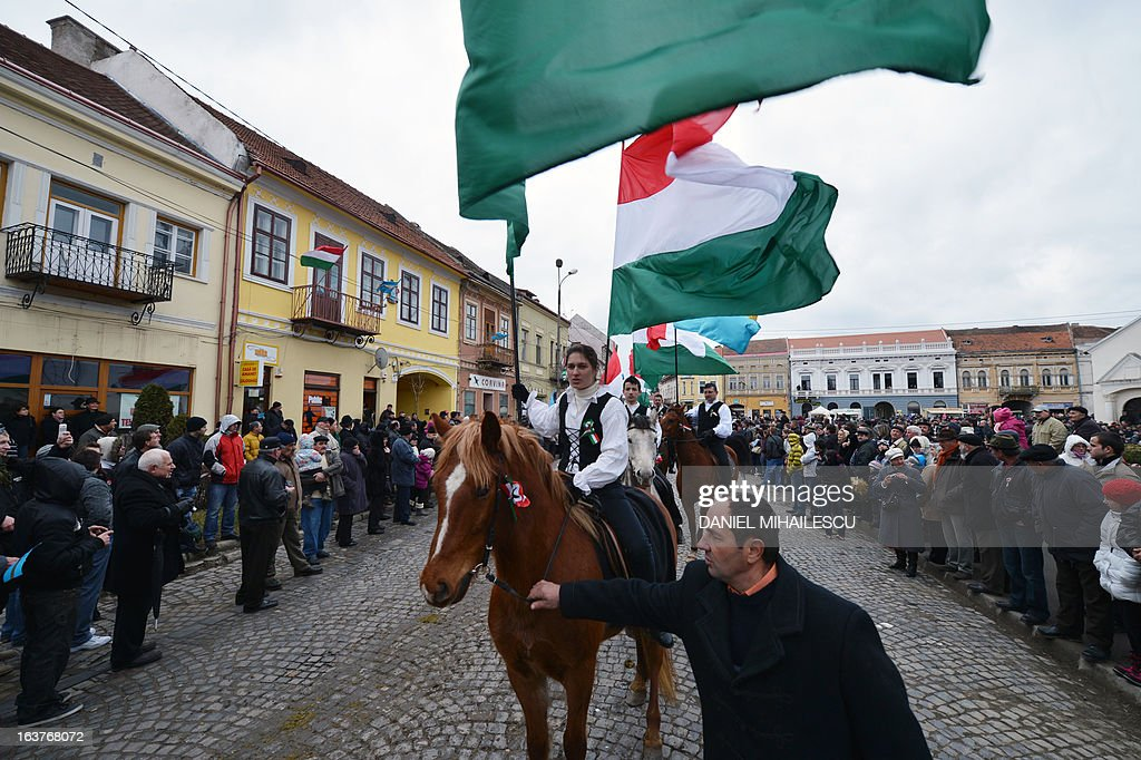 An ethnic Hungarian girl rides a horse while holding the Hungarian flag during a parade on Hungary's National Day in Targu Secuiesc (250km north of Bucharest) on March 15, 2013. Thousands of ethnic Hungarians from the central Transylvanian region of Romania gather in a celebration in Targu Secuiesc to mark the 1848 Hungarian Revolution.