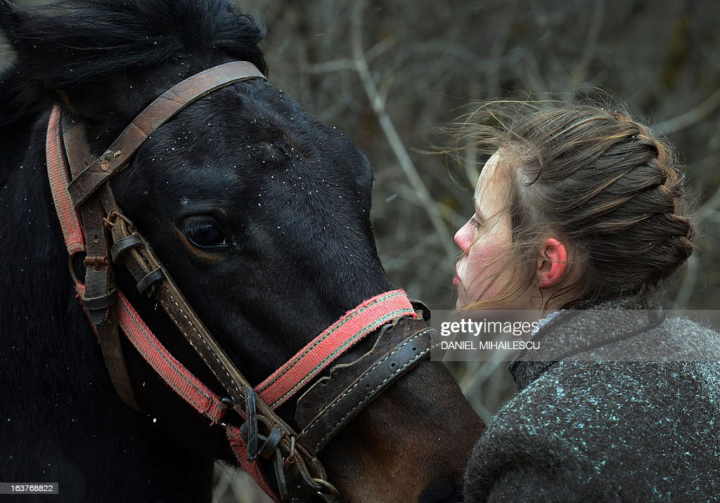 An ethnic Hungarian girl speaks to her horse during a parade on Hungary's National Day in Targu Secuiesc (250km north of Bucharest) on March 15, 2013. Thousands of ethnic Hungarians from the central Transylvanian region of Romania gather in a celebration in Targu Secuiesc to mark the 1848 Hungarian Revolution.