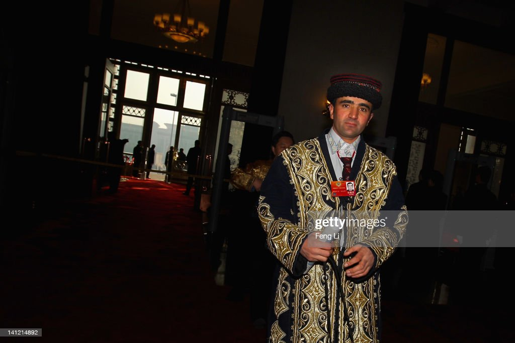 An ethnic minority delegate of Xinjiang arrives at the Great Hall of the People before the closing ceremony of the Chinese People's Political Consultative Conference (CPPCC) on March 13, 2012 in Beijing, China. Known as 'liang hui,' or 'two organizations', it consists of meetings of China's legislature, the National People's Congress (NPC), and its advisory auxiliary, the Chinese People's Political Consultative Conference (CPPCC).