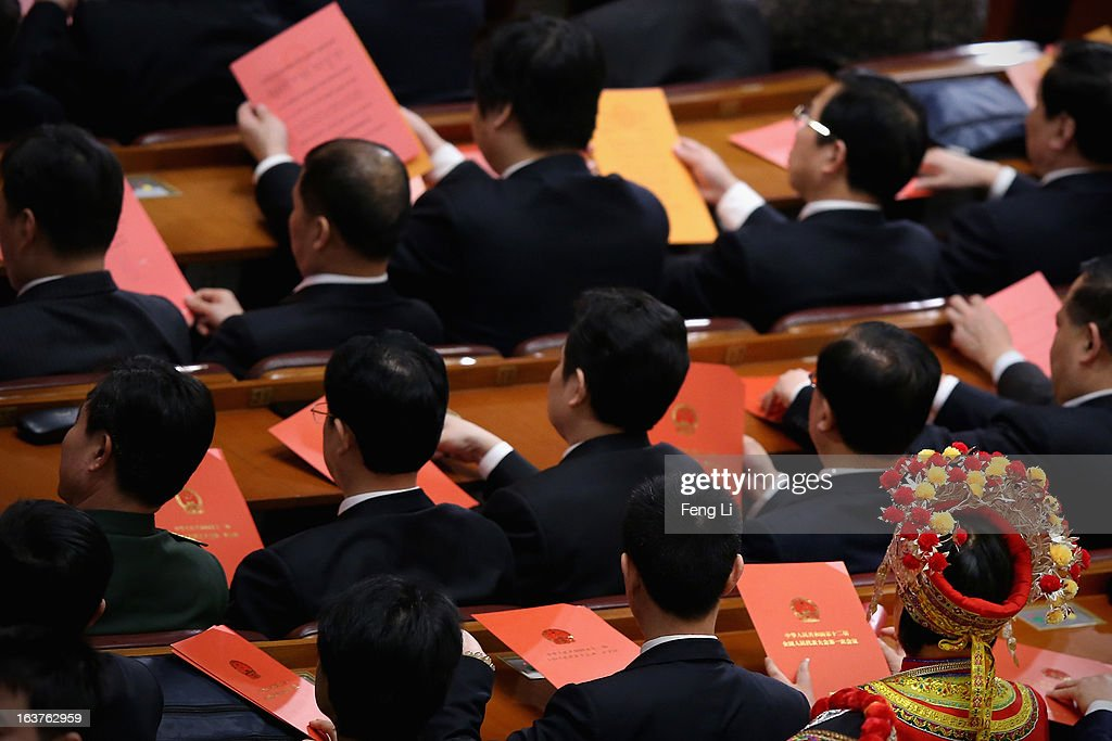 An ethnic minority delegate takes her vote during the fifth plenary meeting of the National People's Congress at the Great Hall of the People on March 15, 2013 in Beijing, China. Li Keqiang was elected as China's Premier Friday at the 12th National People's Congress, the country's top legislature.
