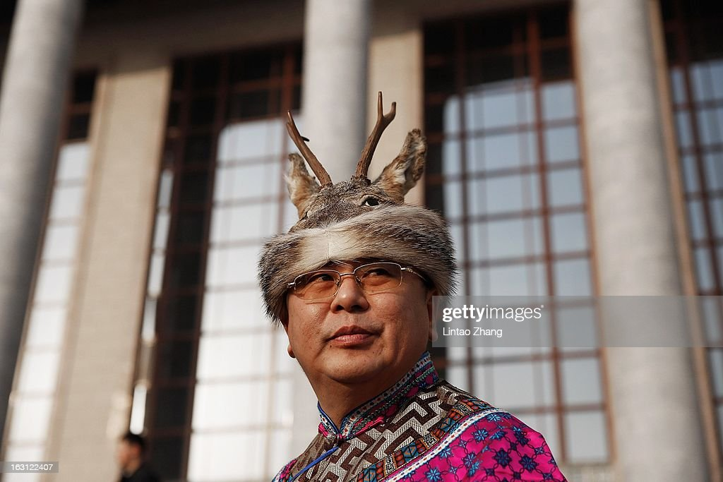An ethnic minority delegate walks to the Great Hall of the People before attending the opening session of the annual National People's Congress at Great Hall of the People on March 5, 2013 in Beijing, China. Over 2,000 members of the 12th National Committee of the Chinese People's Political Consultative, a political advisory body, are attending the annual session, during which they will discuss the development of China. Premier Wen Jiabao's opening report focused on the goals of improved welfare provision, steady economic growth while maintaining social stability.