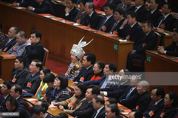 An ethnic minority delegate yawns during the closing ceremony of China's National People's Congress at the Great Hall of the People on March 15 2015...