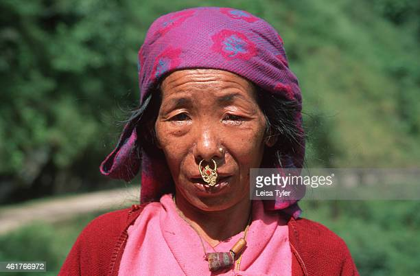 An ethnic Sikkimese woman wearing a traditional nose ring Migrating from the eastern Tibetan kingdom of Kham the Sikkimese have inhabited the small...