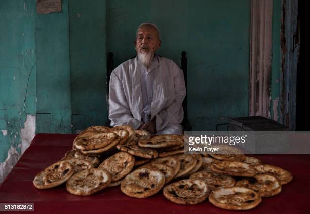 An ethnic Uyghur man sells bread on July 1 2017 in the old town of Kashgar in the far western Xinjiang province China Kashgar has long been...