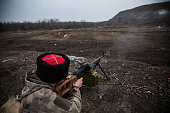 An ethnically Cossack proRussian rebel practices his firearms skills at a firing range on March 12 2015 in Donetsk Ukraine The conflict between...