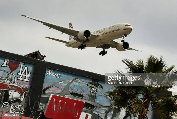 An Etihad Airlines plane from Abu Dhabi prepares to land at Los Angeles International Airport in Los Angeles California on March 22 2017 From...