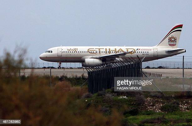 An Etihad Airways plane taxis on the runway at Larnaca airport in the Cypriot southern port city on January 10 2015 AFP PHOTO / HASAN MROUE