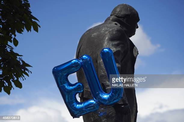 An EU balloon is attached to the Winston Churchill statue in Parliament Square as thousands of protesters take part in a March for Europe through the...