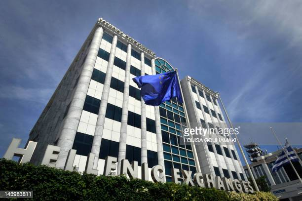 An EU flag flies in front of the Athens stock exchange on May 7 2012 after voters in France and Greece voted out their ruling parties in a backlash...