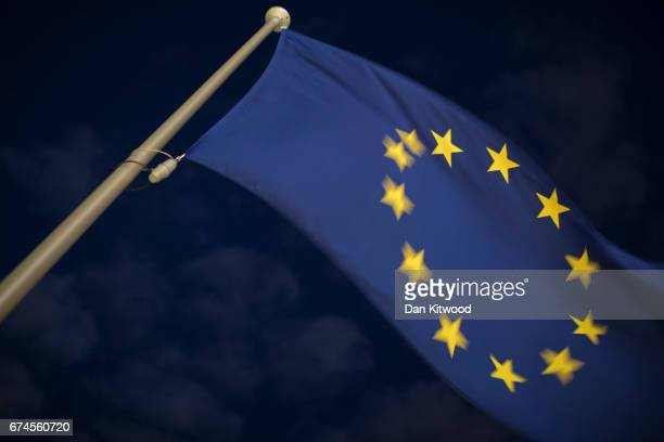 An EU flag flies near the European Union Commission headquarters on April 28 2017 in Brussels Belgium The 27 members of the European Union will meet...